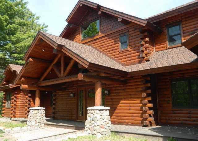 lodging lodge cedar northern rental sale on wisconsin for in wi lake dsc cabins vacation dells private